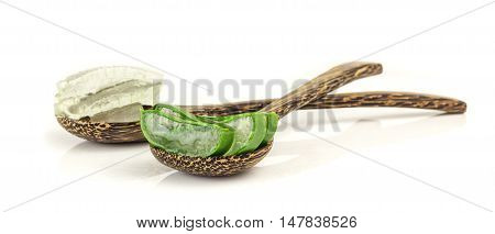 Fresh Slice Aloe Vera And Gel On  Wooden Spoon On White