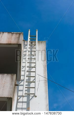 exterior of building with the fire escape.blue sky background poster