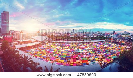 Panorama aerial view of Multi-colored tents in Rod-Fai market at sunset Bangkok Thailand. Vintage color filtered.