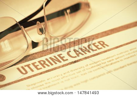 Uterine Cancer - Printed Diagnosis with Blurred Text on orange Background with Spectacles. Medicine Concept. 3D Rendering.