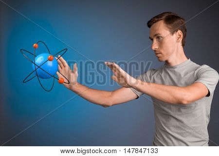 Man scientist with atom model, research concept