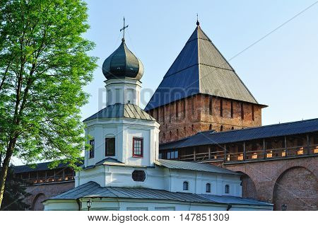 Church of the Intercession and the Tower of intercession of the Novgorod Kremlin in Veliky Novgorod Russia at summer sunset - architecture closeup view