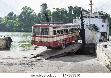 Andaman Island, India - March 18 2016: Shutter Bus Crossing River.