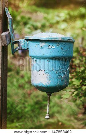 Old vintage washstand hanging outdoors, retro toning.