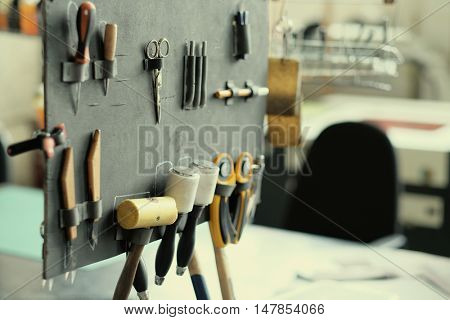 Leather crafting tools in workshop
