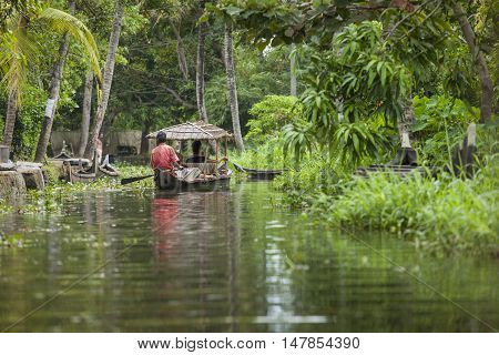 Alleppey, Kerala, India - August 16, 2016: Unidentified Indian People In Small Boat In Backwaters. K