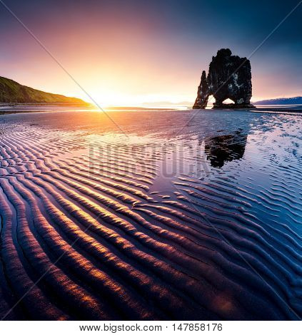 Spectacular embossed black sand after the tide. Picturesque and gorgeous scene. Location famous place Hvitserkur rock, Vatnsnes peninsula, northwest Iceland, Europe. Tourist attraction. Beauty world.