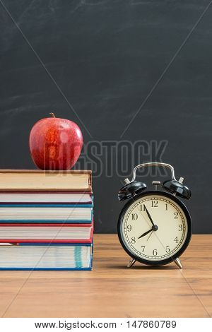 Red Apple And Alarm Clock On School Desk For Back To School