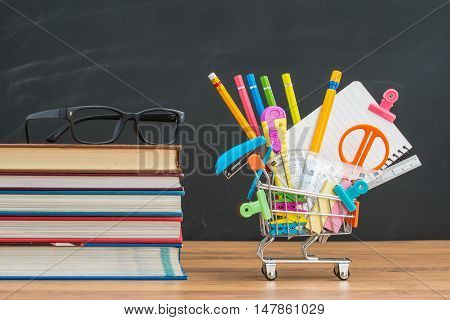 Shopping Cart Filled With Back To School Supplies With Study Glasses
