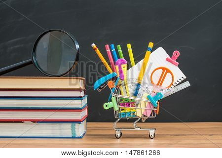 School Equipment With Textbook On Desk For Back To School