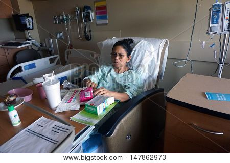 JOLIET, ILLINOIS / UNITED STATES - SEPTEMBER 4, 2016: A patient recuperates at the Presence Saint Joseph Medical Center in Joliet.