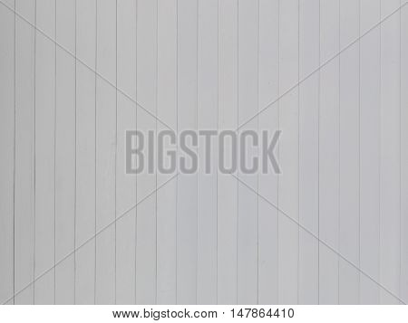beautiful surface of an old white-gray wall of colored light vertical white boards with thin seams