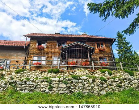 Famous Curmatura cottage refuge, in Piatra Craiului, mountain of Transylvania, in Zarnesti Romania poster