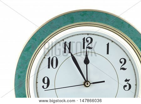 Almost twelve o'clock on big wall clock isolated on white close up