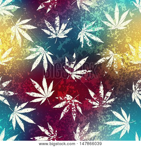 Seamless background pattern. Rastafarian blur background and grunge hemp leaves.