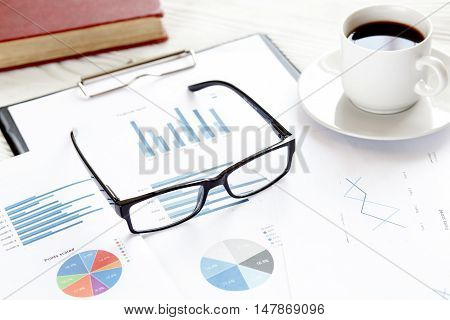 economist table with report and calculator top view