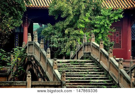Deyang China - November 5 2009: One of three Pan Bridges with their stone stairs and lion balustrades spanning the Pan Pond and leading to the Dacheng Gate at historic 13th century Deyang Confucian Temple