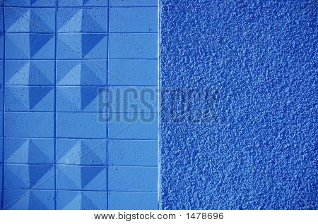 Blue painted brick wall with diamond and stone textures poster