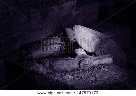 trowel and pickaxe mason working tool and stove-setter