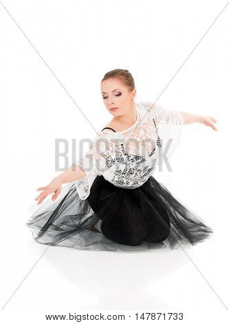 Full length portrait of young beautiful dancer posing on isolated white studio background. Pretty woman - modern style dancer or ballerina in ballet pose.