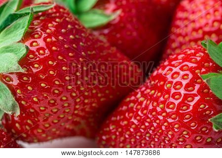 Red Strawberry, red close up strawberries with selective focus on a strawberry with many strawberries in the background for food or fruit close up background or strawberry texture.