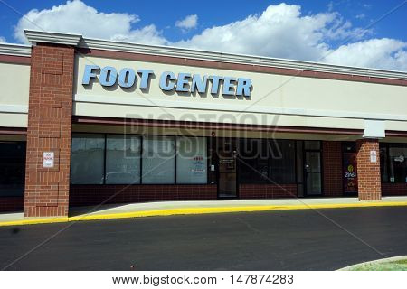BOLINGBROOK, ILLINOIS / UNITED STATES - SEPTEMBER 17, 2016: The Bolingbrook Foot and Ankle Center, P.C. offers free foot screenings at the Marketplace at Barber's Corner strip mall in Bolingbrook.