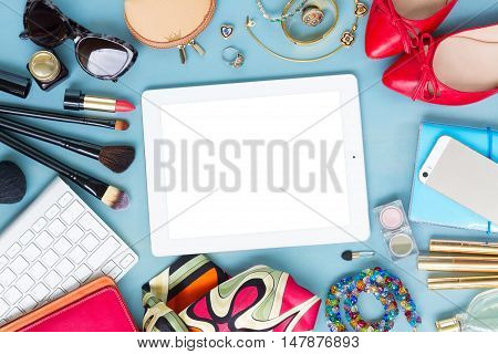 styled feminine desktop - woman fashion items on blue wooden background, copy space on white tablet screen