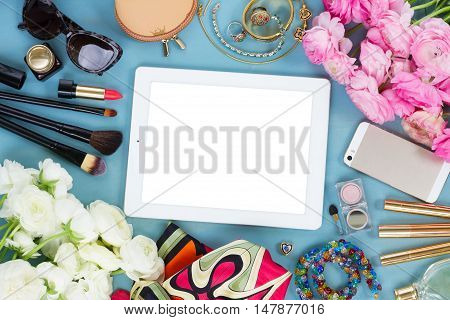 styled feminine desktop - woman fashion items on blue background with flowers