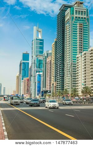 Dubai, United Arab Emirates - May 1, 2013: street view of Sheikh Zayed Road in Dubai Downtown with its modern skyscrapers and towers with billboards. Dubai highways, roads.