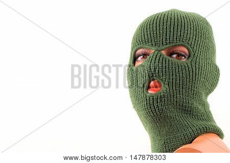 Green balaclava mask on manikin's head on a white background