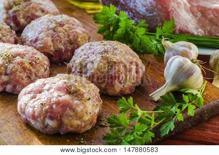 raw patties formed from ground beef freshly ground