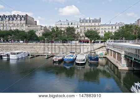 PARIS, FRANCE-AUGUST 09, 2016: boats in the Bassin de l Arsenal west of the Place de la Bastille