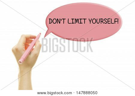 Woman hand writing DON'T LIMIT YOURSELF message on a transparent wipe board.