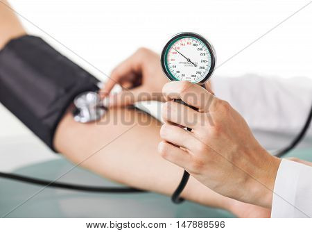 Closeup of a Doctor Taking Blood Pressure