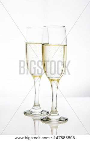 Champagne in glass cups on white background