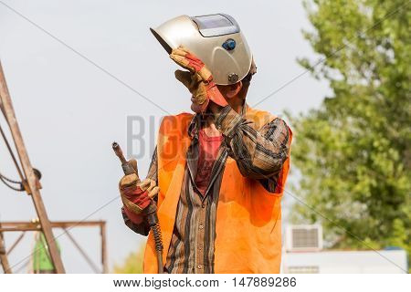 Unidentified Worker Working With Concrete Iron At A Construction Site