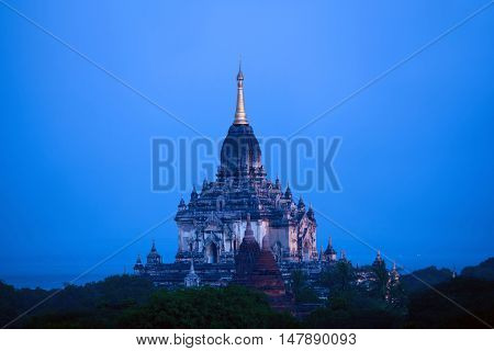 Ancient Gawdawpalin pagoda at twilight in Bagan archaeological zone Myanmar. Bagan's prosperous economy built over 10000 temples between the 11th and 13th centuries.