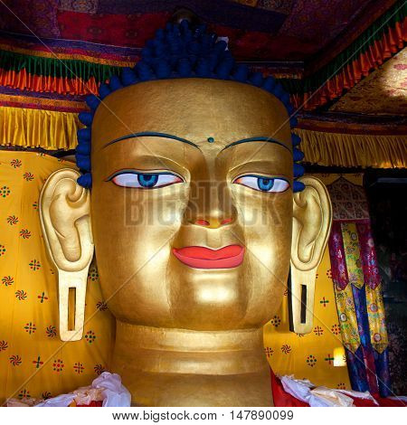 LEH, INDIA - JUNY 11: Beautiful sculpture of Gautama Buddha at Shey Monastery on Juny 11 2013 in Leh, Ladakh, Jammu and Kashmir state. The main Shakyamuni Buddha statue in the monastery is a 12 metres (39 ft) icon covering three floors of the monastery.