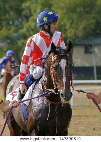 Pyatigorsk, Russia - September 18,2016: Before a race Pyatigorsk, largest hippodrome in Russia.Myrzabek Kappushev-one of the best jockeys of Russia, on September 182016.