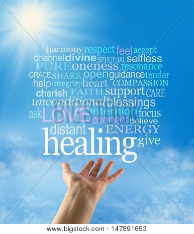 Sending out beautiful healing intention - female hand palm up with a large HEALING word floating above and a word cloud on a blue sky background with a sunburst and sun rays beaming down