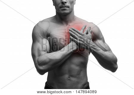Heart attack middle aged muscular man with chest pain isolated on white background black and white photo with red dot