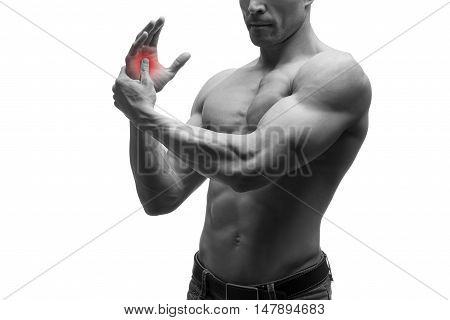 Pain in hand carpal tunnel syndrome muscular male body studio isolated shot on white background with red dot black and white photography