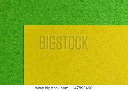 Eva foam ethylene vinyl acetate lemon yellow surface on apple green sponge plush background