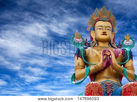 LADAKH, INDIA - JUNE 14, 2012: Statue of Maitreya Buddha near Diskit Monastery facing down the Shyok River towards Pakistan in Nubra Valley.