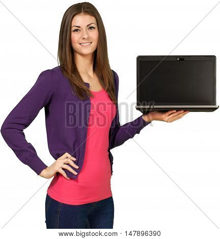 Friendly Young Woman Standing with Hand on Hip and Holding Laptop - Isolated