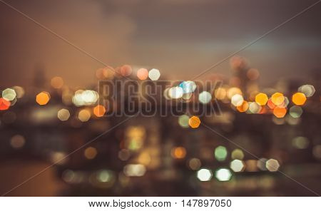 blurred lights cityscape at night with vintage tone : city blur