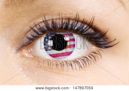 Flag of the United States of America in beautiful female eye