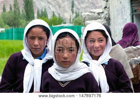TURTUK, INDIA - JUNE 13, 2012: Balti students poses for a photo during their break time in Turtuk Village, Ladakh.