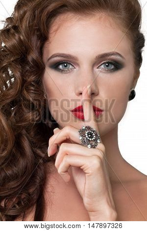 Closeup of Beautiful Woman with Finger on Lips