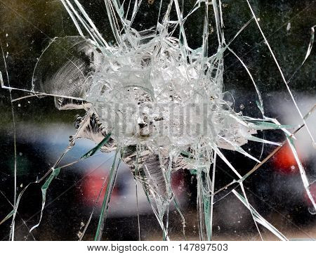 pucture of a Broken bus window inside from accident